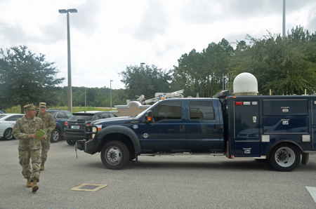 The National Guard is here. Members of the Air and Army National Guard dropped in at EOC, with a communications vehicle, around 11:30 this morning. (© FlaglerLive)