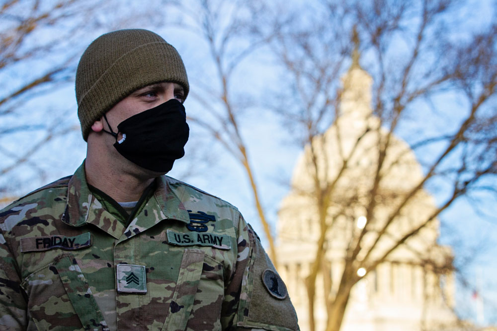 A member of the Delaware National Guard stand watch near the U.S. Capitol building, Washington D.C., Jan. 9, 2021. National Guard Soldiers and Airmen from several other states have traveled to the District to provide support to federal and district authorities leading up to the 59th Presidential Inauguration. (National Guard)