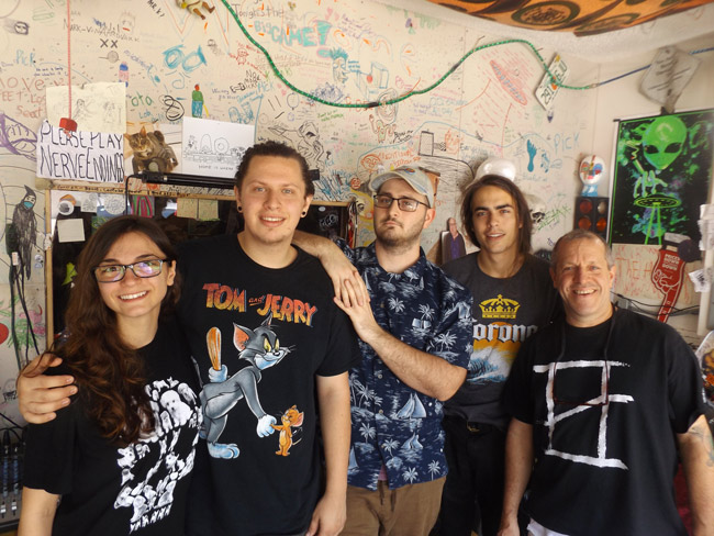 "Pictured in The Ned's recording studio and rehearsal space in Palm Coast are, from left: Marissa LiCausi of the band Flora LiCrame, The Ned drummer Joe Gardella, The Ned PR/booking manager Justyn Perry, The Ned singer-guitarist Trace George, and The Ned manager Artie ""Papa Ned"" Gardella. (© FlaglerLive)"