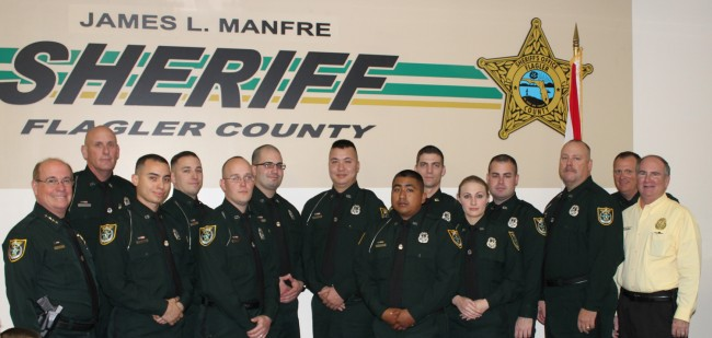 The new ranks: from left, Sheriff Jim Manfre, Cleo Howe, Emmanuel Cardenales, Andrew Cangialosi, John Collins, Christopher Alecrim, Anthony Monroe-Warren, David Berriozabal, Aaron Beausoleil, Shayna Favorite, James Crosbee, Carl Parker, Senior Commander Steve Cole and Undersheriff Rick Staly. Click on the image for larger view.
