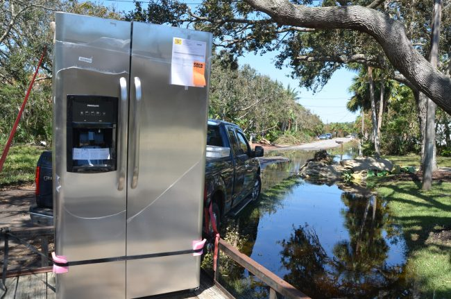 A new fridge was atFlagler Beach City Commissioner Rick Belhumeur's house this morning, replacing one destroyed by the flood. Click on the image for larger view. (c FlaglerLive)