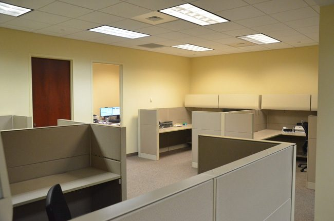 Floor space at the county courthouse that would be additionally granted for sheriff's uses, above, was featured earlier this month in an image the sheriff circulated to county commissioners and the media, showing sheriff's personnel crammed around the cubicles during a briefing on a murder investigation. The door to the left is to Cheif Paul Bovino's office. The door to the right is the clerk's records manager's office, who would vacate the space. (© FlaglerLive)