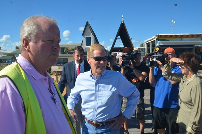 U.S. Sen. Bill Nelson, center, took a walk on the Flagler Beach pier Wednesday morning with City Manager Larry Newsom, right, and County Commission Chairman Barbara Revels. County Administrator Craig Coffey is just behind the senator. (© FlaglerLive)
