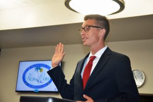 Nick Klufas takes the oath. Click on the image for larger view. (© FlaglerLive)