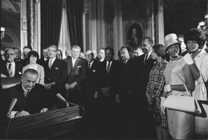 Lyndon Johnson signs the act.