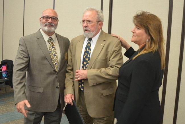Palm Coast Council member Bob Cuff, center, has consistently ensured with his tie-breaking positions that charter-review proposals by Steve Nobile, left, and Heidi Shipley, right, did not get far. (© FlaglerLive)