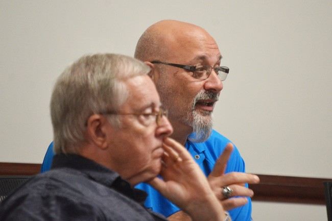 Council member Steven Nobile (his finger raised) wants council salaries to be raised to around $40,000. Bill McGuire, in the foreground, disagrees. (c FlaglerLive)