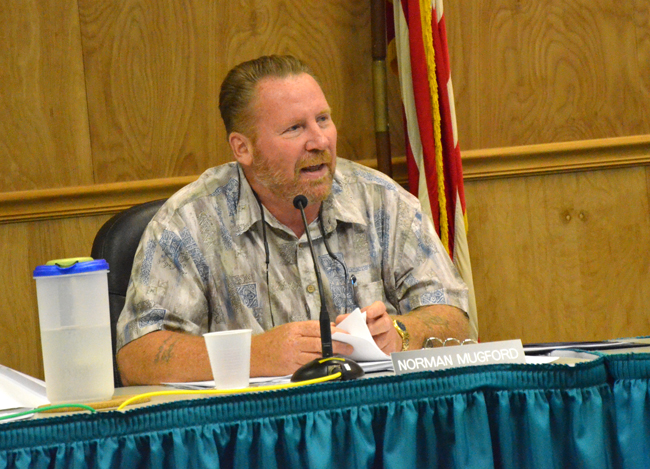 Code enforcement power: Norman Mugford, a member of Palm Coast's code enforcement board, speaking about the pain of solicitors--and the city's and the sheriff's office's inaction, at a meeting in early July. Both have since responded, jailing unlicensed solicitors. (© FlaglerLive)