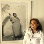 "Photographer Lisette Otero-Lewis, owner of Galleria d'Arte in Palm Coast, with her work ""Joy Within."" (© FlaglerLive)"