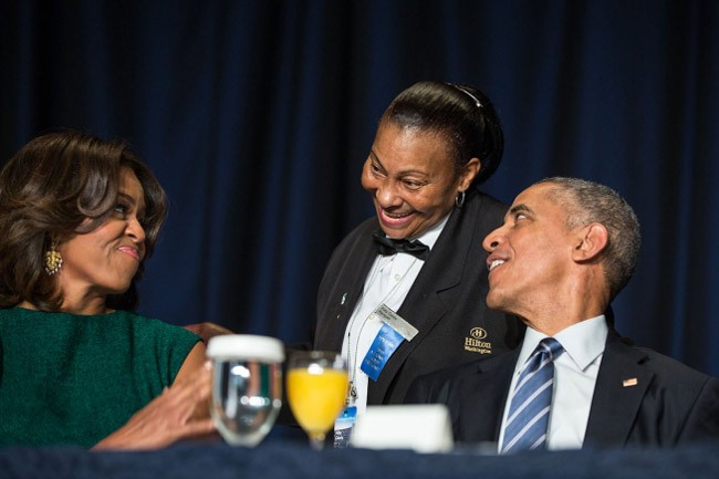 President Barack Obama and Michelle Obama with Hilton banquet server Kitty Casey during the National Prayer Breakfast at the Washington Hilton in Washington, D.C., Feb. 5, 2015. (White House)