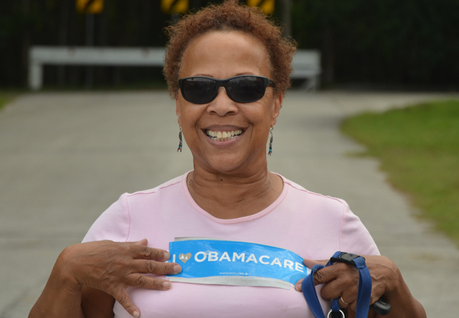 'I snatched it off my car,' Barbara Frazier said of her Obamacare sign as she joined Tuesday's demonstrators in front of the Flagler County Health Department. (© FlaglerLive)