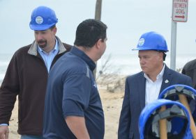 Commissioner Donald O'Brien, seen here at the kick-off of the dunes restoration project with Sen. Travis Hutson and Coffey, may need the hard hat at the next couple of commission meetings: he's now the panel's chairman.  (© FlaglerLive)