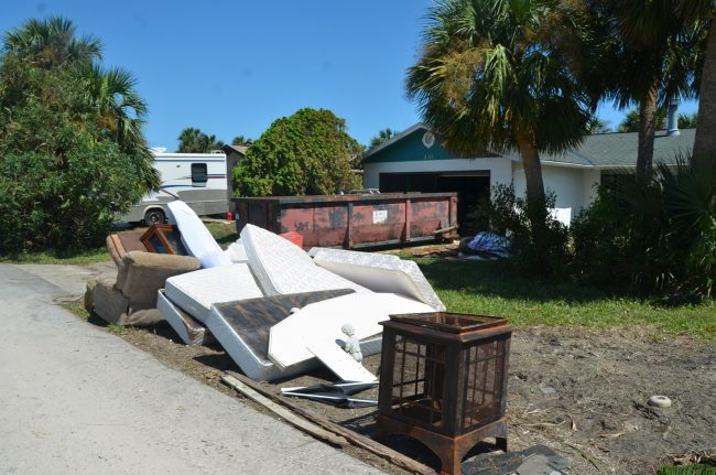 Dumpsters have been brought in on Ocean Palms. Click on the image for larger view. (c FlaglerLive)
