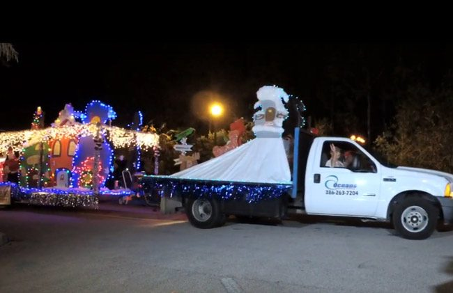 Oceans Fence and Railing, above, won Best Float in Saturday's Starlight Parade through Palm Coast's Town Center, Lowe's won Best of Parade, FPC won Best Marching Unit, Innovative Dance Company won Best Decorative Vehicle, and Matanzas won Best School Pride. See the full video under Announcements below.