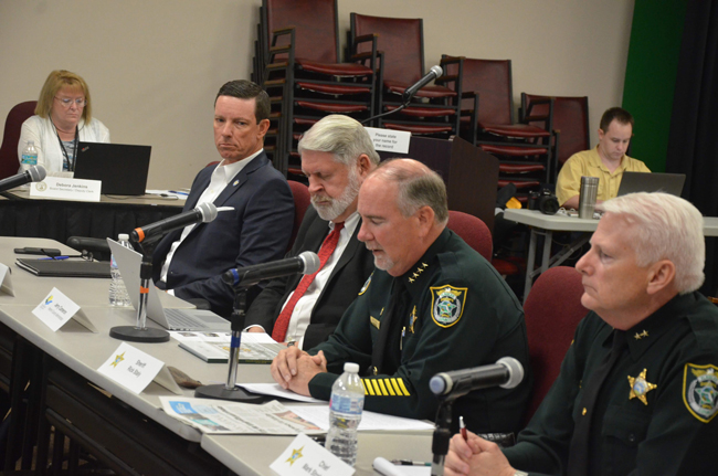 The officials at the center of the issue: from left, Clerk of Court Tom Bexley, County Administrator Jerry cameron, Sheriff Rick Staly and Sheriff's Chief Mark Strobridge. (c FlaglerLive)