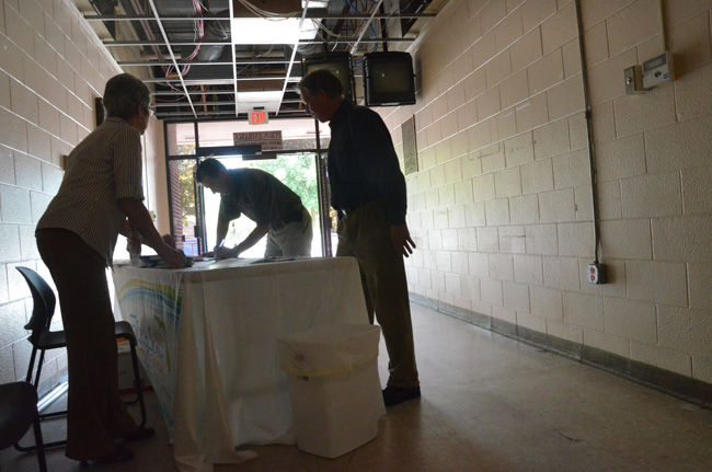 Several dozen people turned out at a county-hosted open house Friday at the old Flagler County Courthouse. To be safe, they signed in--so the county could ensure that all had exited the structure when it was shut down again. (© FlaglerLive)