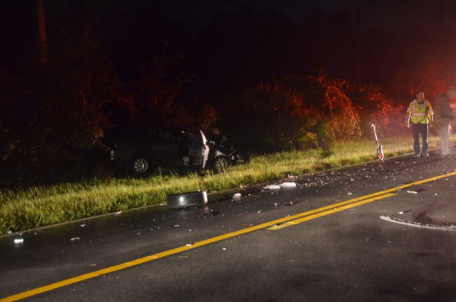 Crash debris on Old Kings Road, near the Corolla. Click on the image for larger view. (© FlaglerLive)