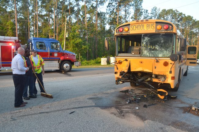 The school bus after the SUV was removed. Superintendent Jacob Oliva is to the left. Click on the image for larger view. (© FlaglerLive)