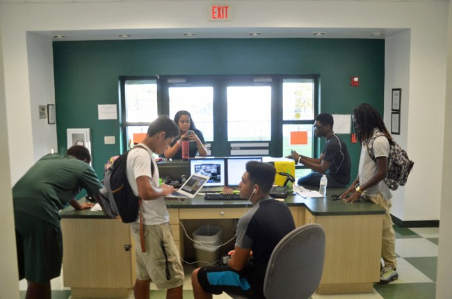 Students, seen here at the Flagler County Youth Center, are never far from their school-issued computers. (c FlaglerLive)