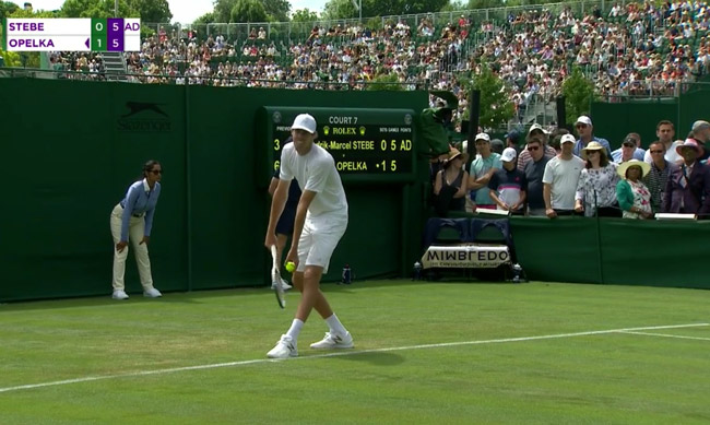 Reilly Opelka on his way to winning his first Wimbledon en's draw match today. He faces Stan Wawrinka in the second round.