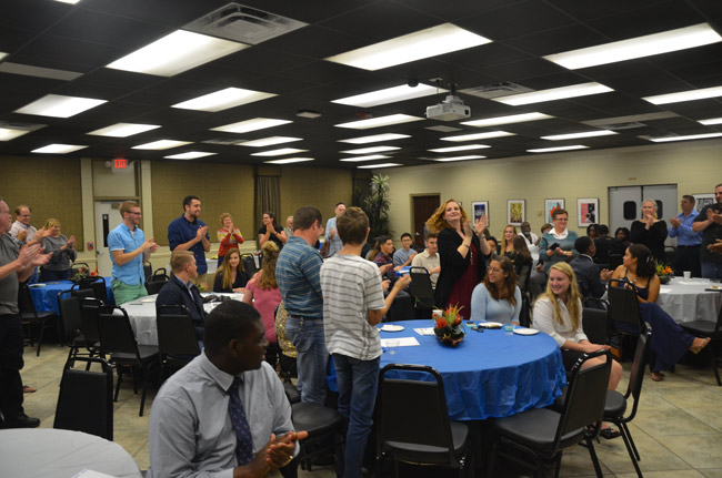 An ovation for the 40 students who made up the 2017 IB Class at FPC, 31 of whom earned the IB diploma, a 74 percent success rate that exceeds the world average by three points. They returned to FPC's Bistro on Dec. 21 for a diploma remittance ceremony. (© FlaglerLive)