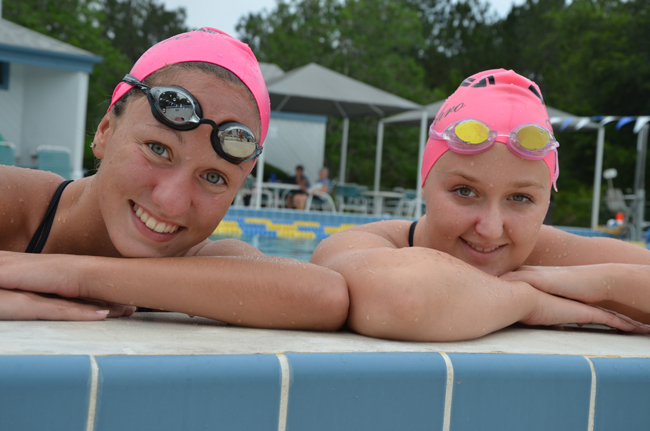 Paige Wells, left, and Melanie Watkins are graduating high school and the Synchro Belles program and will be joining synchronized swimming teams in college: the top-ranked Ohio State Buckeyes for Wells, the Gators for Watkins. (© FlaglerLive)