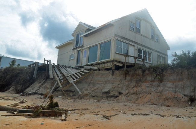 One of the houses more severely affected by erosion following Hurricane Matthew. It's among the houses getting a seawall soon. (© FlaglerLive)