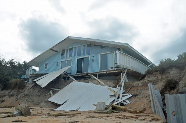 One of the more heavily damaged houses on Painters Hill, just south of Varn Park, in unincorporated Flagler County, as seen from the ocean. Click on the image for larger view. (© FlaglerLive)