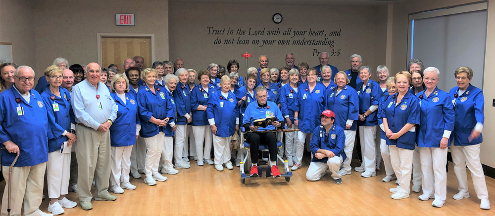 """The AdventHealth Palm Coast volunteer auxiliary donated $10,000 to AdventHealth Palm Coast. The volunteers raised these funds through various activities, such as holiday and gift shop sales. The donation will support the purchase of new, upgraded wheelchairs that will increase patient's comfort and improve mobility for volunteers and transportation employees. """"Our volunteer auxiliary team is proud to continue supporting AdventHealth Palm Coast and the surrounding community,"""" said Tom Sisti, volunteer auxiliary president. """"Our team works hard every day to assist with our patients and guests."""" """"We appreciate our volunteers and the impact they have on our patients and visitors,"""" said Wally De Aquino, AdventHealth Palm Coast chief operating officer. """"We are very thankful for their generous donation."""""""