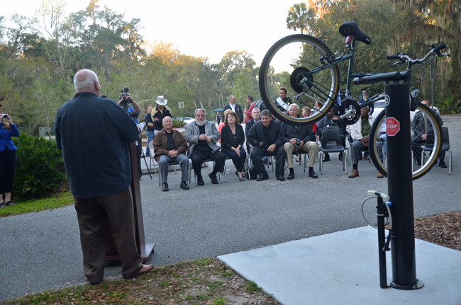 Palm Coast Mayor Jon Netts dedicated the city's third bike maintenance station along Linear Park Tuesday morning. (© FlaglerLive)