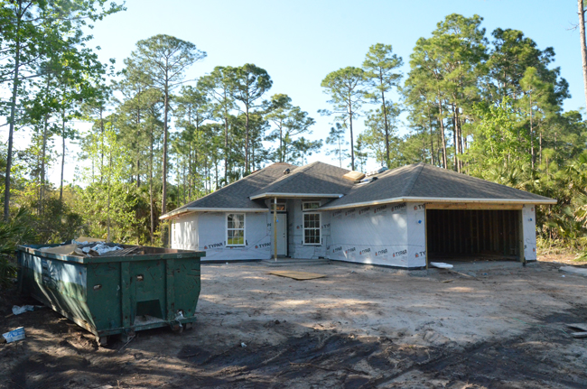An increasing sight in Palm Coast again. This one is going up on Point Pleasant. (c FlaglerLive)