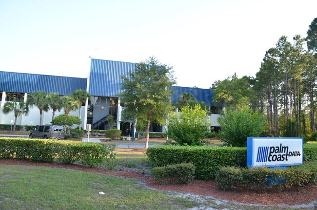 The 70,000 square foot building that had been Palm Coast City Hall until 2008 was leased to Palm Coast Data for $240,000 a year before the city sold it outright for a relative pittance of $3 million as part of an economic development incentive deal, one of the city's lesser successes, as the company has shed jobs for most of the decade and struggled to maintain its hold in the subscription fulfillment industry. (© FlaglerLive)