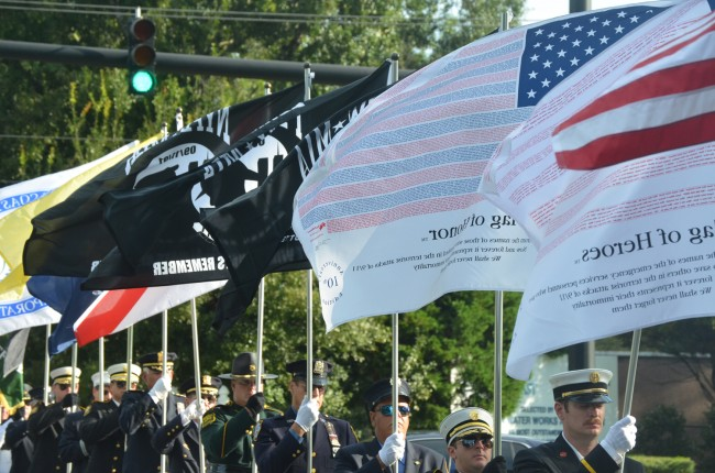 The Parade of Flags at this mornings 9/11 ceremony at Palm Coast's Heroes Park includes the flags of first responders in Flagler and New York. Click on the image for larger view. (© FlaglerLive)