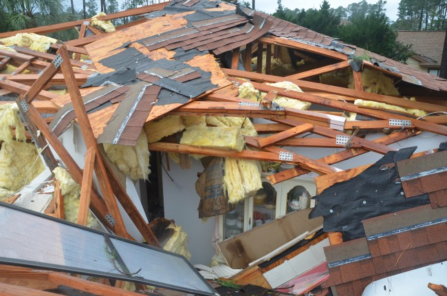 A house on Palm Coast's Barrenwrood Lane and Bayside Drive after the December 2013 tornado. (© FlaglerLive)
