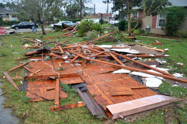 One roof ended up in a neighbor's yard across the street. Click on the image for larger view. (© FlaglerLive)