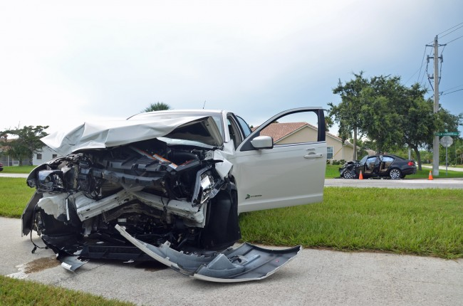 What was left of the Ford Fusion driven by 83-year-old David Quinn of Palm Coast. Click on the image for larger view. The BMW is in the background. (© FlaglerLive)