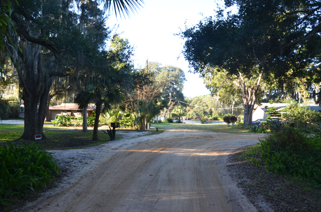 Pamela Parkway, a dirt road off A1A, curves right  just before a residential lot, at the end of which is the boat ramp, which had no barriers. (© FlaglerLive)