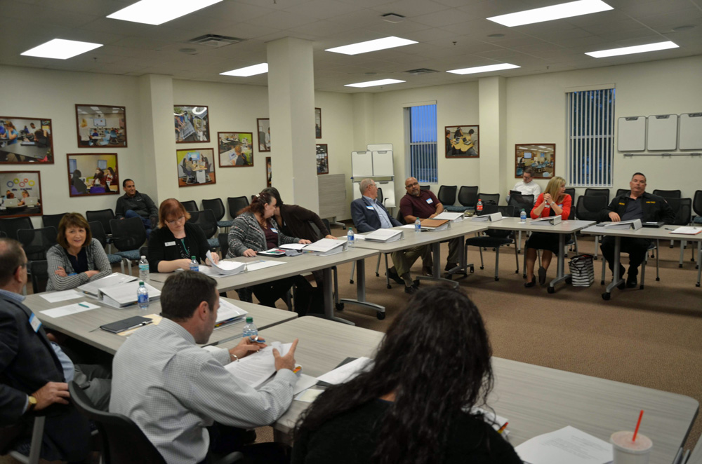 Members of the Citizens Advisory Committee appointed by the school board to recommend a selection of candidates for superintendent, just before their first meeting at the Government Services Building in Bunnell Tuesday evening. (© FlaglerLive)