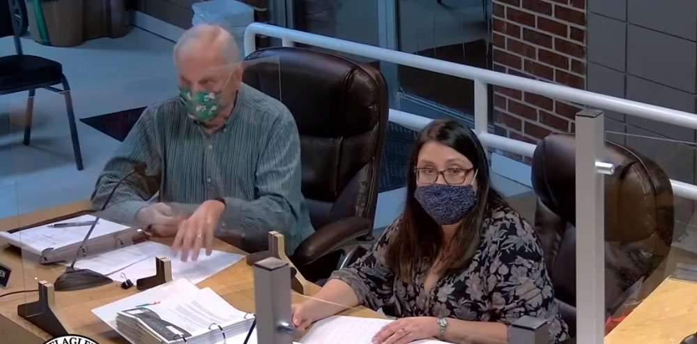 Ken Parker, left, is the retired Port Orange City Manager. He's been helping the Flagler Beach City Commission filter through its list of applicants for managers. (© FlaglerLive via YouTube)