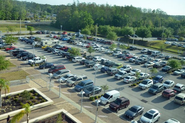 A jammed parking lot at the county courthouse reflected the 500-some potential jurors called in for selection today, three time the usual number. (c FlaglerLive)