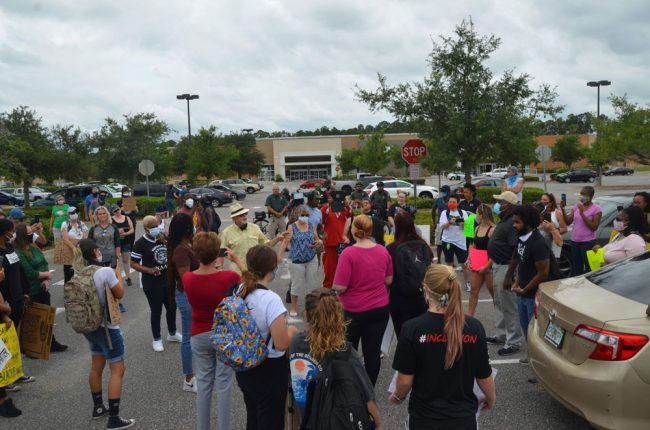 In the parking lot before the march. (© FlaglerLive)