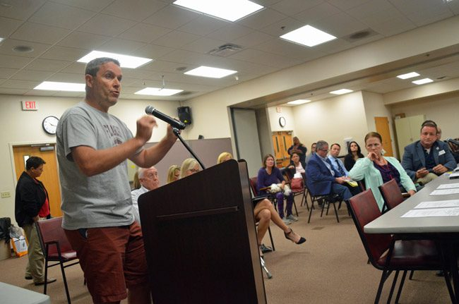 James Bellino, the pastor at Bunnell's Church on the Rock, speaking to the Public Safety Coordinating Council this morning, with the council's chairman, Joe Mullins, to the right. (© FlaglerLive)