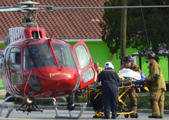 One of the two patients being loaded on Fire Flight. Click on the image for larger view. (© FlaglerLive)