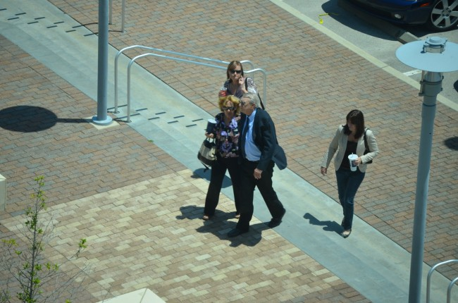 Paul Miller's last steps in freedom, around lunchtime, as he was walking back to the courthouse after a stop at Wendy's with his wife and daughter and one unidentified person. Click on the image for larger view. (© FlaglerLive)