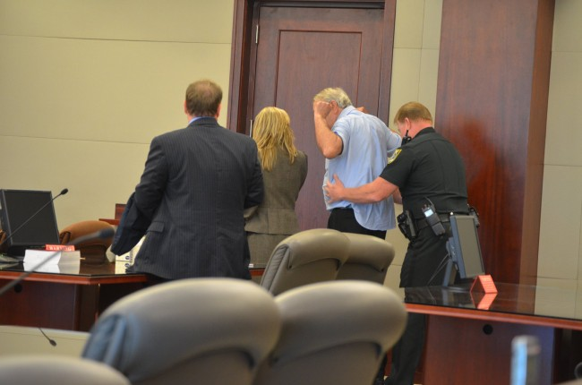 Miller was patted down and his belt and jacket removed before he was taken into custody. Click on the image for larger view. (© FlaglerLive)