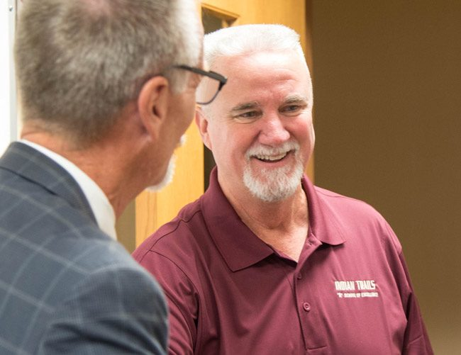 Paul Peacock with Superintendent Jim Tager Tuesday. (Flagler Schools)