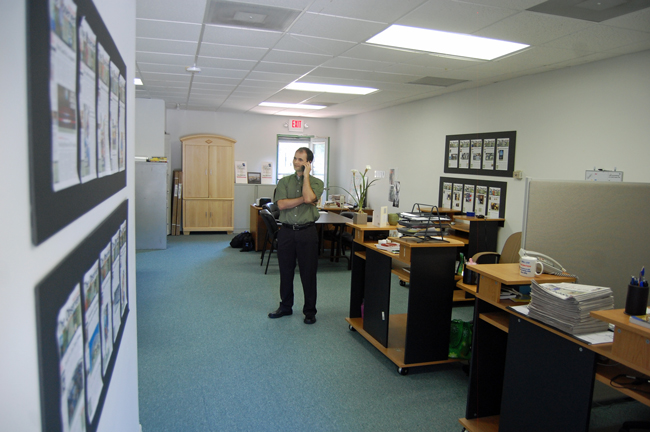 Palm Coast Observer Managing Editor Brian McMillan at the paper in 2011, before the expansions to twice a week and into Ormond Beach. (© FlaglerLive)