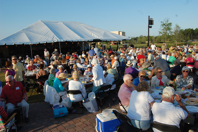 First the food, the wine, the beer, then the music, the wine, the beer, and more, with the Jacksonville Symphony Orchestra under the bog tent at Town Center. (© FlaglerLive)
