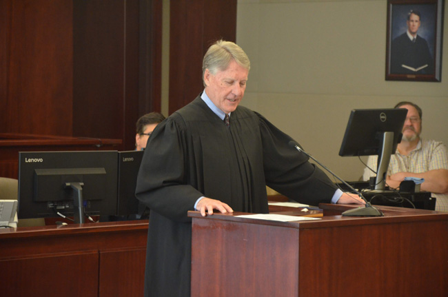 Circuit Judge Terence Perkins speaking at Flagler County's drug court graduation in March, when four participants graduated. (c FlaglerLive)
