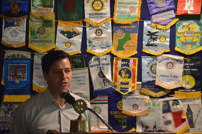 Pomeroy Equitable Solutions CEO Peter Riggio says he often hears that his Swipe 4 the Kids venture is too good to be true, but is quick to explain why the novel way of underwriting non-profits can work for local businesses, at no cost to them or their customers. He spoke before the Flagler County Rotary on Tuesday. (© FlaglerLive)